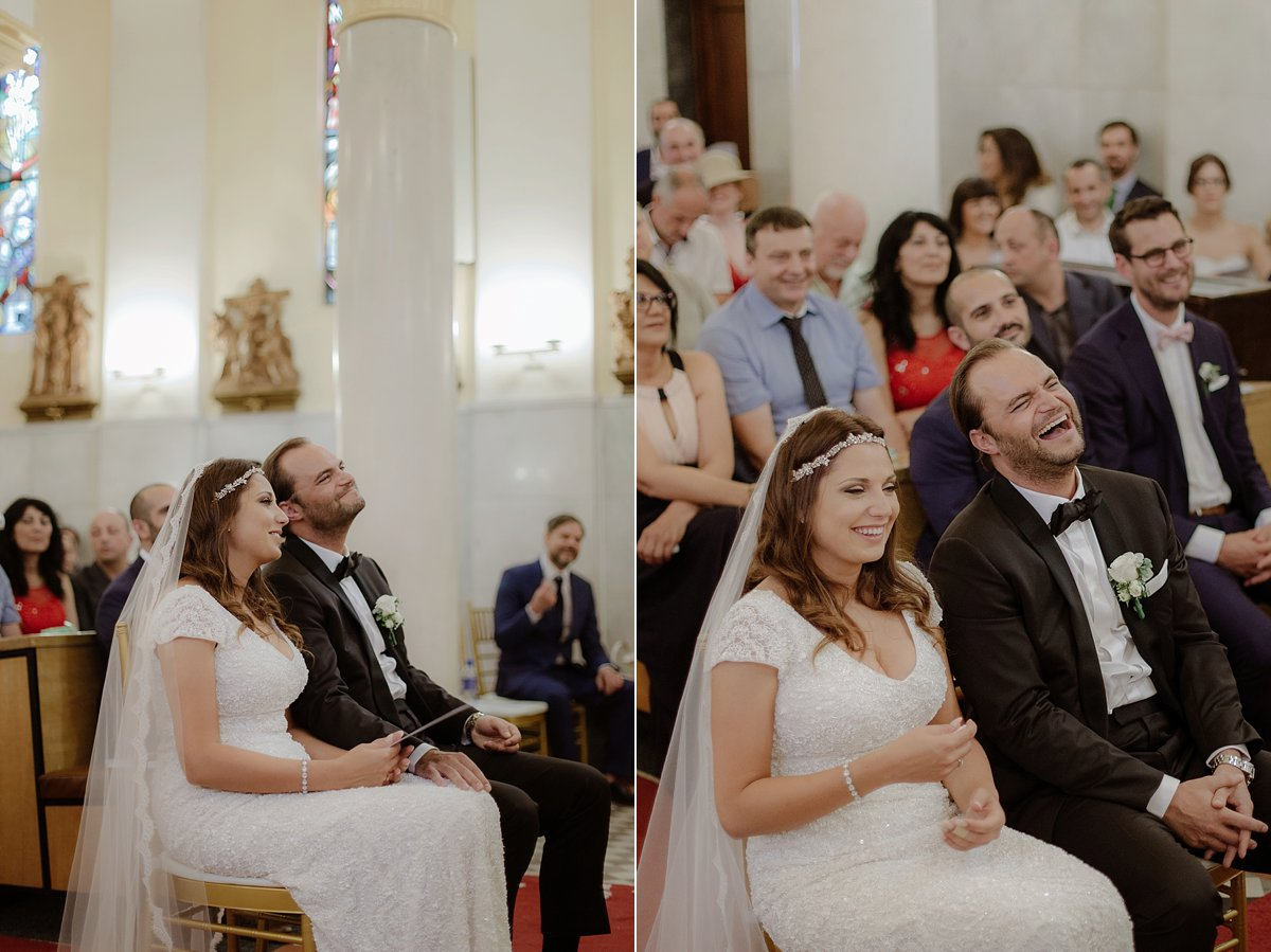 bride and groom laugh at ceremony
