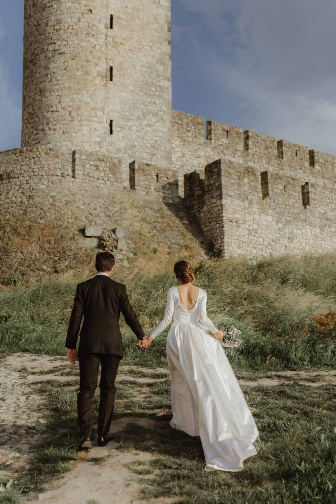 Beautiful satin dress in historical castle wedding